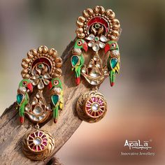 The Exotic Parrot Earrings from Apala by Sumit would leave you spellbound! Look exuberant in this Vibrant Indian colour palette! Indian Jewelry Earrings, Jewelry Design Earrings, Gold Earrings Designs, Gold Jewellery Design, India Jewelry, Enamel Jewelry, Crystal Jewelry, Bridal Jewelry, Gold Jewelry