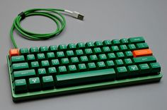 From techmattr. TEX green aluminum case with lip, Nuclear data keyset. Custom cable.