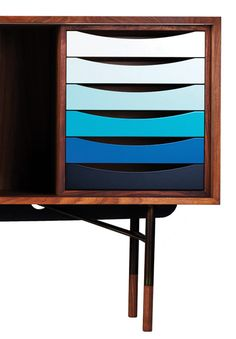 Sideboard by Finn Juhl, 1955. A walnut cabinet on a steel frame. Originally manufactured by Bovirke, Denmark, official reproduction by OneCollection.