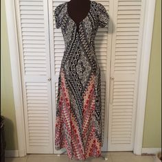 Stunning Maxi style tribal Dress  JUST REDUCED This dress is like NWOT.  Absolutely beautiful.  Has what looks like 3 splits in front as seen in 3rd photo.  I put green fabric under to try to show the beautiful bottom.  Buttons down to mid thigh.  ❤️♥️❤️ Fire Los Angeles Dresses Maxi