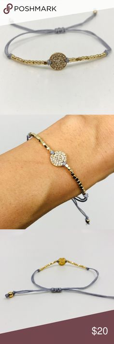 Dainty Adjustable Bracelet w/ Pave Design This darling bracelet is great for layering. Beautiful pave design charm has eleven beads on each side. The gold- tone is subtle and very flattering on skin. Bracelet has adjustable silk string made to fit all. It's the perfect gift for someone special or yourself!   Lightweight and OH SO PRETTY!!!  Silk string is Gray Color Jewelry Bracelets