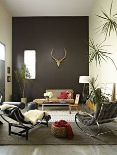 Brown wall design living room couch original leather gold accents stone wall