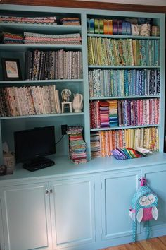 Sewing Room by Cut To Pieces. Great fabric storage.