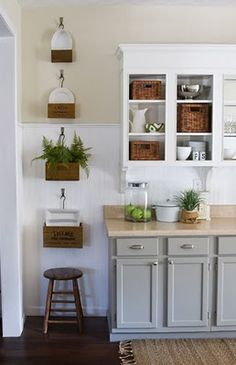 Grey cabinets with butcher block and white shelves
