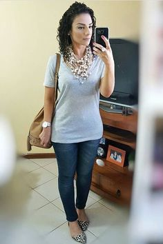 necklace; gray t-shirt; jeans pants; animal print shoes