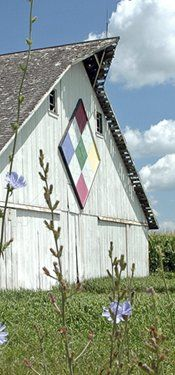 Barn quilts are painted quilt squares-usually fashioned on boards and then mounted on a barn or other building. While cloth quilts are usually made up of a series of squares of the same pattern placed together, a barn quilt is almost always a single square.