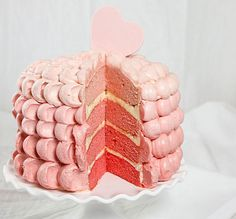 Four-Layer White Cake with Vanilla Bean Swiss Meringue Buttercream - each layer tinted with different shade of red, moist and flavorful cake is decorated using simple Petal technique