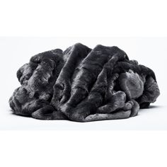 Beautiful throw can be used for day bed cover or throw blanket for a chair. The throw is very light and soft. Snuggle up by the fire or in bed with the amazingly warm faux fur throw. Perfect for freezing nights to overnight guest and everything in between. This throw will add an elegant look to any room!
