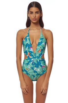 One piece monokini with plunge halter neckline, twist front detail, and open back. Ties at neck and back, reverses to solid teal.