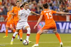 Jessie Fleming #17 of Canada tries to move the ball past Merel Van Dongen #15 of the Netherlands during the 2015 FIFA Women's World Cup Group A match at Olympic Stadium on June 15, 2015 in Montreal, Quebec, Canada.