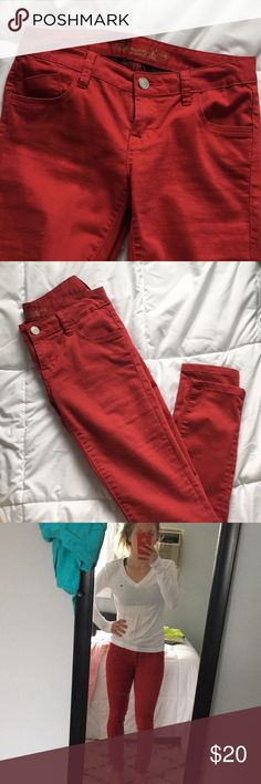 "American Rag Red Jeans Excellent condition red jeans by American Rag. Worn once when I went through a colored jean phase. 29"" inseam. 7"" rise. Real pockets. Size 3 S (for short I'd imagine but inseam is regular so check that that length works for you). White Lacoste v neck long sleeve sold separately. American Rag Jeans Skinny"