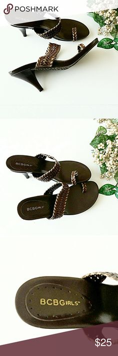 BCBGirls Whipstitch Thongs Approx 3in. comfy heels. Toe ring thongs. Gorgeous gold whipstitch trim around toe ring and single cross foot strap, all your n brown leather Wonderful grip type sole to prevent slipping. Be sexy & highlight your pedicure!  EUC *Ask Questions B4 You Buy!*#poshmark #poshstyle #poshmarkseller #shopmycloset #buymystuff  #newstuff #fashionforless #shop #lowprices  #quickship #newfashion #fashion #suggesteduser #shoes #cuteshoes #bestdeals #poshing #style BCBGirls Shoes…