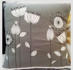 Grey flowered cushion