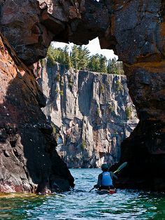 Arch / Paddling through a sea arch on the way to Shovel Point, Lake Superior, Minnesota, USA.