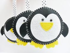 like as is and also idea use paper plates to make into a tamborine for winter music play Penguin Felt Christmas Decorations Christmas Projects, Felt Crafts, Holiday Crafts, Diy Crafts, Felt Christmas Decorations, Felt Christmas Ornaments, Hanging Decorations, Penguin Ornaments, Diy Ornaments
