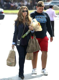 I'll be back: Christopher Schwarzenegger sported a sweater emblazoned with his father's name on it as he joined his mother Maria Shriver at Whole Foods on Tuesday, 13 October 2014.