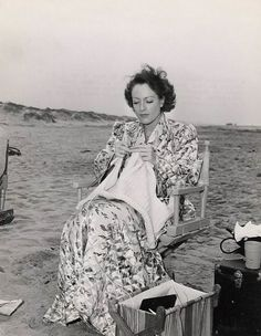 1940. Joan Crawford knitting on the set of 'Strange Cargo'.