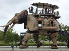 The Great Elephant is 12 metres high, can carry 40 passengers and walks slowly while spraying water and trumpeting.  It was built by Les Machines de I'île, an artistic and tourist project based in Nantes, France. A 45 minute ride costs 7 Euro.