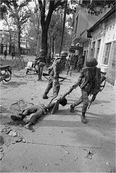 The Bitter End - May 6, 1970 - In Saigon over the past week, 450 civilians were killed during Viet Cong terrorist raids throughout the city, the highest weekly death toll to date. Soldiers drag away a dead VC soldier in Saigon