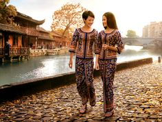 """In the early 1970′s Pierre Balmain was commissioned by Singapore Airlines to re-design the flight attendants' uniforms, and thus created the iconic """"Singapore Girl,"""" whose look was loosely based on the traditional Indonesian costume, kebaya."""