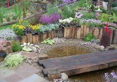 black pebble garden with timber bridge - Google Search