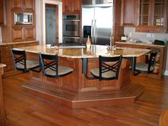 Catalina Chairs on standard hidden frame. - bar stools mounted under countertop, easy cleanup, takes up less space...