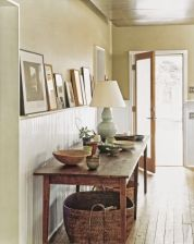 Sometimes adding character to your home is as easy as building onto the architectural details you've already got. By topping existing wainscoting, for instance, with a deep ledge, shown, the wall paneling does double duty as a display shelf for artwork or platters. If your existing cap rail stands an inch or so away from the wall, you can replace it with a 1x3 ledge without any additional support. Just use finishing nails to fasten the ledge to the top of the wainscoting after applying co...