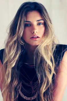 Long wavy ombre hair.