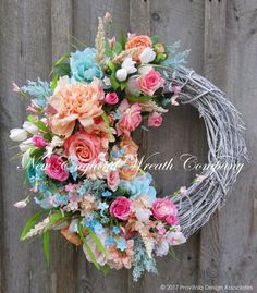 Country French Cottage Garden Wreath. An exquisitely detailed Designer Masterpiece! Lush blossoms and greenery flourish in abundance upon a whitewashed grapevine wreath. A beautiful and very full arra