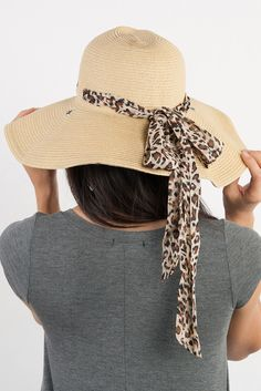 This Leopard Floppy Straw Hat would be great for a shimmering day at the beach not only would you look stylish wearing it but it would also help protect you from the sun!!