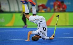 Germany's Mats Grambusch falls during a field hockey game against Canada. - Carl de Souza/AFP/Getty Images