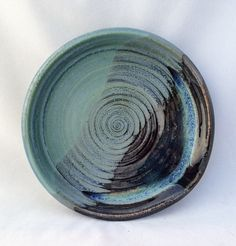 Stoneware pottery spoon rest, green, black, and blue glaze, with spiral throwing marks - pinned by pin4etsy.com