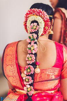 South Indian bride. Temple jewelry. Jhumkis.Pink silk kanchipuram sari with contrast blouse.Braid with fresh flowers. Tamil bride. Telugu bride. Kannada bride. Hindu bride. Malayalee bride.