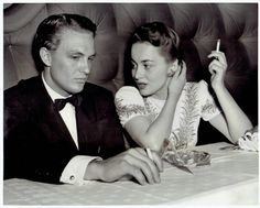 Robert Stack and Olivia de Havilland