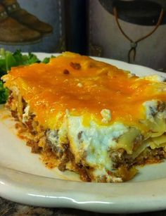 Cheesy Noodle Meat Bake.. Guaranteed to clean your Plate! Great casserole meal for a big family dinner or small leftovers are just as good.