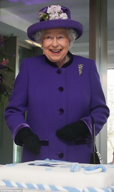 Queen Elizabeth II was seen beaming after the cutting of the cake during a visit to the In...