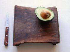 Two of my favorite things - gorgeous wood, and avocado!  Walnut Cutting Board Rustic Wood Serving Tray by grayworksdesign on Etsy.