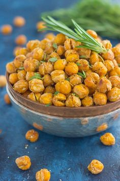 These Roasted Parmesan Herb Chickpeas are a healthy way to satisfy those snack cravings. Filled with fresh rosemary, thyme, oregano and a sprinkling of Parmesan cheese, these crunchy chickpeas are full of flavor and irresistibly delicious!