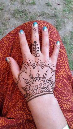 My hand, my henna.