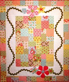 I made this quilt and it turned out so super cute.  did it in lime, tourquoise and fushia.