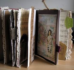 Art journal from old book -- and note resource for free collage stuff...