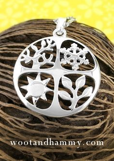 Here is a necklace for all seasons. There's a winter snowflake, a summer sun, budding springtime stems, and autumn leaves.