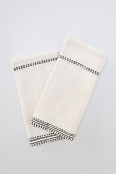 """100% hand-woven Ethiopian cotton. Natural with a striped design in gray. Sold individually.Fair Trade Federation certified.  Approx. 20"""" x 20""""  Handmade in"""