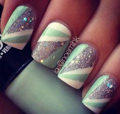 Mint green, white, and silver glitter nail design