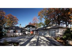 Don't you love the contrast of a sleek modern home with warm fall foliage? Click to see more photos of plan DHSW076066.