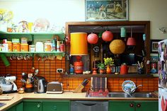 so much color! I love the cluttered madness of this kitchen, but... it would probably drive me batty.