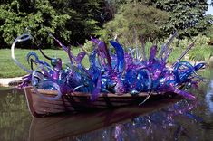Why Yes! I would like a boat full of Chihuly glass on the lake behind my house Thank you!!!!