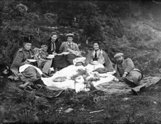 1890s - chilly Victorian picnic (Scotland? It's certainly woolly-plaidy-tweedy!).