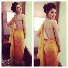 yellow sari with literally a backless blouse but not really lol sooooo sexy <3 love it!