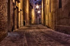 narrow dark alley in the old town - street at night in the Italian city photo